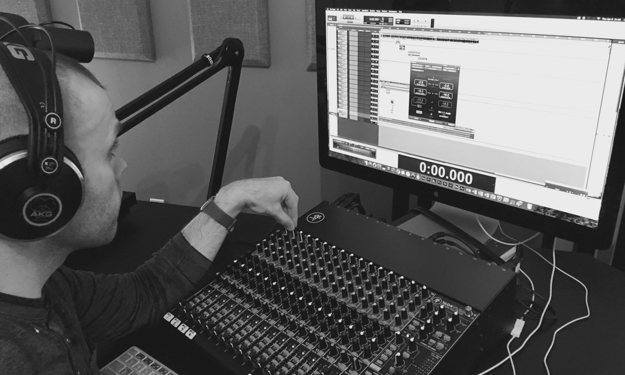 Alex Knight at the mixing console, working on sound designing a podcast in Avid Pro Tools.